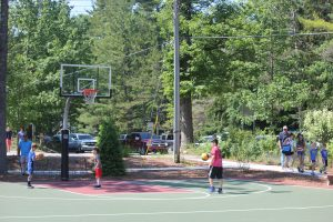 kids playing on basketball courts