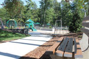 park bench sidewalk and playground