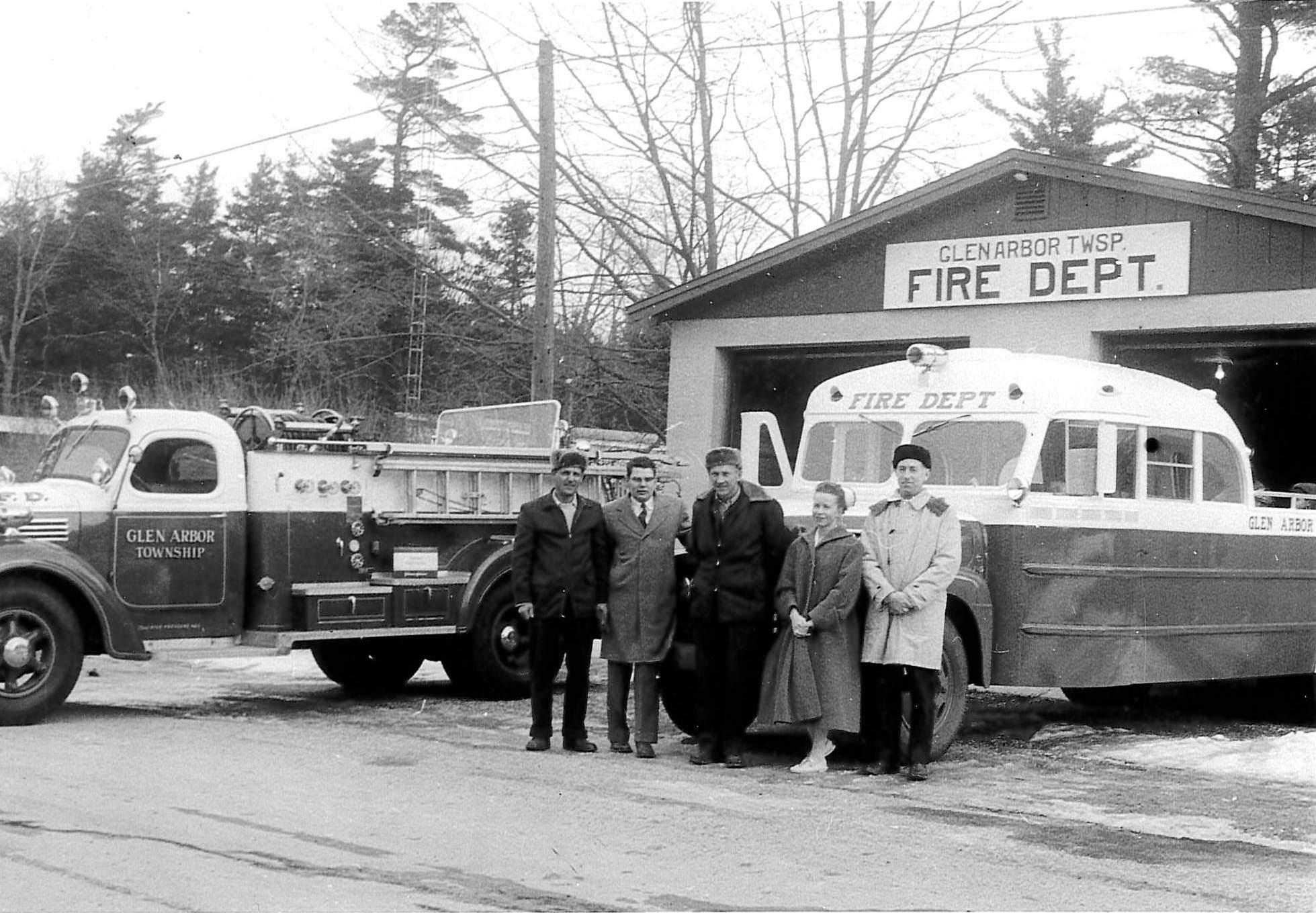 historic photo of the first fire truck and bus converted