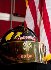 glen lake firefighter helmet up close - American flag in background