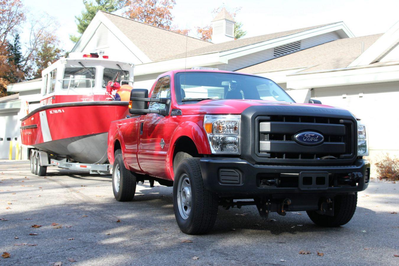 utility 381 truck pulling fire rescue boat