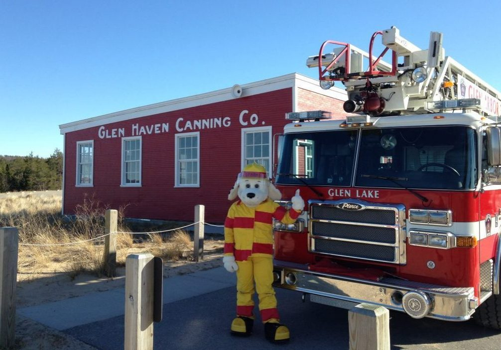 dog fire dept mascot in front of cannery at glen haven